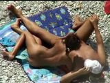 Voyeur Tapes Amateur Hottie Giving A Gentle Handjob On Public Beach